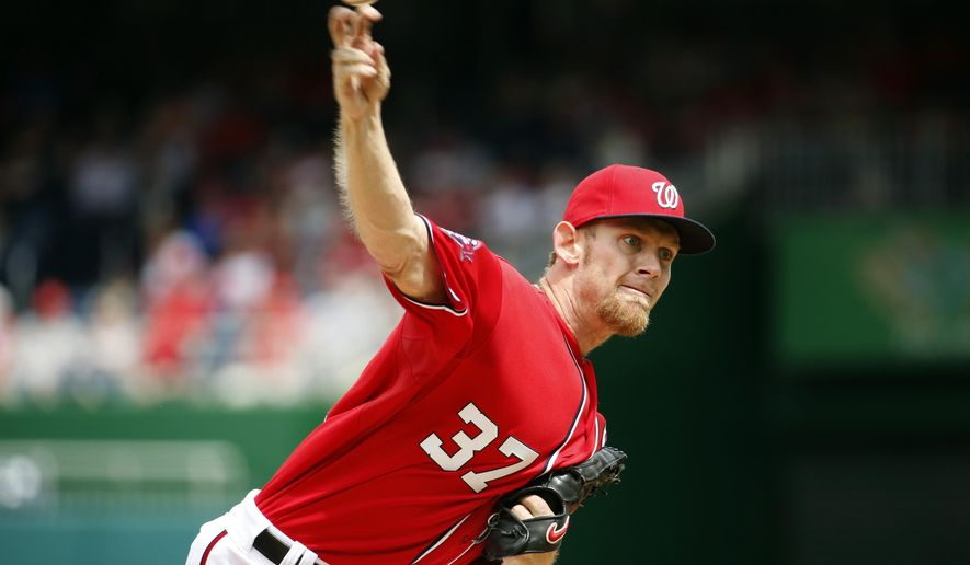 Washington Nationals starting pitcher Stephen Strasburg (37) throws during the third inning of a baseball game against the Philadelphia Phillies at Nationals Park, Sunday, April 19, 2015, in Washington. (AP Photo/Alex Brandon)