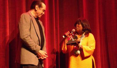 "Chaz Ebert gives actor/writer Chazz Palminteri a ""Golden Thumb."""