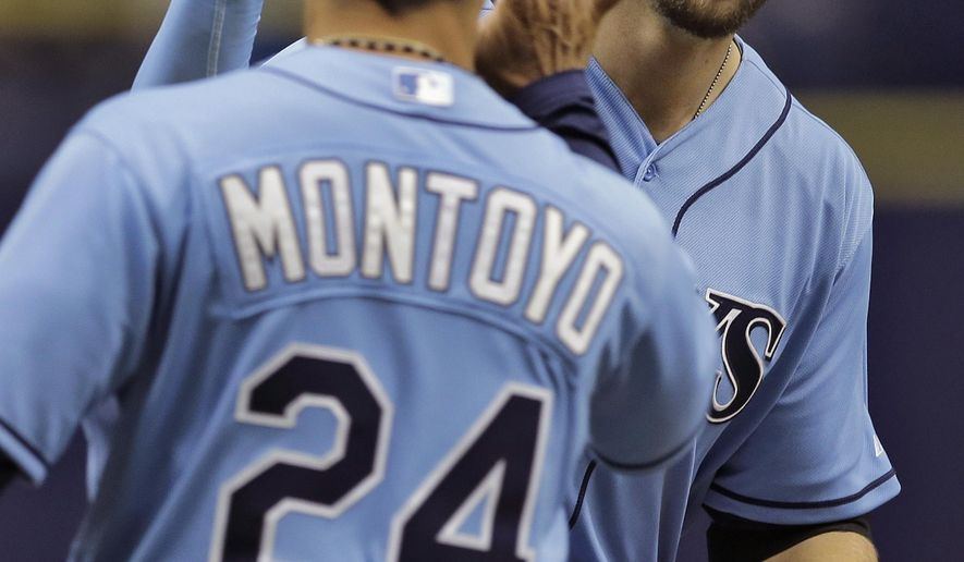 Tampa Bay Rays' Steven Souza Jr., right, high-fives third base coach Charlie Montoyo after hitting a two-run home run off New York Yankees starting pitcher Michael Pineda during the first inning of a baseball game Sunday, April 19, 2015, in St. Petersburg, Fla. Rays' David DeJesus also scored. (AP Photo/ChrisO'Meara)