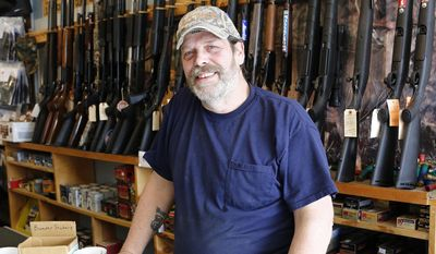 Shooter's Paradise owner Paul Barrett stands inside his store in Sioux City, Iowa, Tuesday, March 31, 2015. (Jim Lee/The Sioux City Journal via AP) ** FILE **