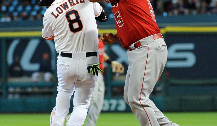 Houston Astros Jed Lowrie (8) reaches first on a dropped third strike as Los Angeles Angels first baseman Albert Pujols gets the ball too late in the fifth inning of a baseball game Sunday, April 19, 2015, at Minute Maid Park in Houston. (AP Photo/Eric Christian Smith)