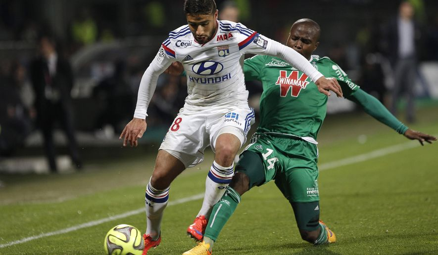 Lyon's Nabil Fekir, left, challenges for the ball with Saint-Etienne's Joel Nguemo Tsafack, right, during their French League One soccer match, in Lyon, central France, Sunday, April 19, 2015. (AP Photo/Laurent Cipriani)