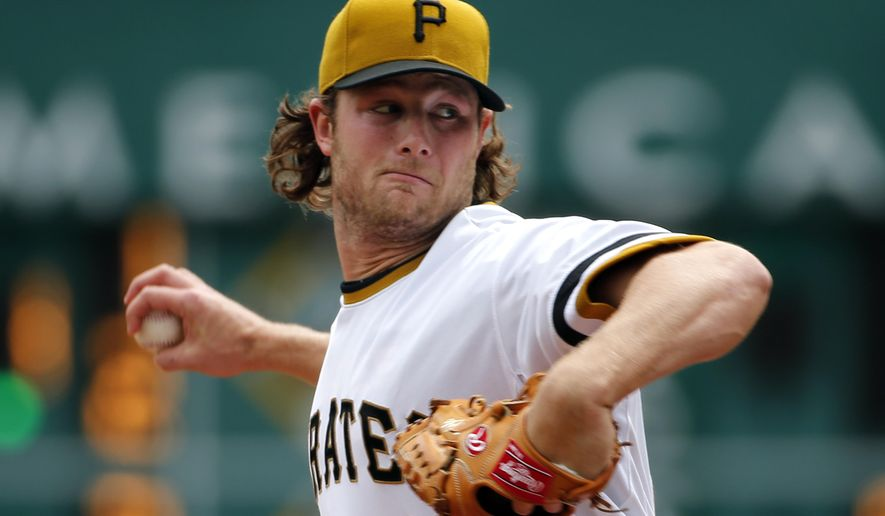 Pittsburgh Pirates starting pitcher Gerrit Cole (45) throws in the first inning of a baseball game against the Milwaukee Brewers in Pittsburgh, Sunday, April 19, 2015. (AP Photo/Gene J. Puskar)
