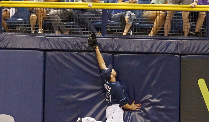 Tampa Bay Rays Steven Souza (20) can't get to New York Yankees Brian McCann's (34) two run triple during the sixth inning of a baseball game, Saturday, April 18, 2015 in St. Petersburg, Fla. (Jim Damaske/The Tampa Bay Times via AP)  TAMPA OUT; CITRUS COUNTY OUT; PORT CHARLOTTE OUT; BROOKSVILLE HERNANDO TODAY OUT