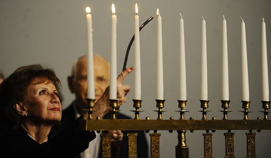 A fourth candle is lit in memory of Rabbis, teachers and scholars who were murdered during the Holocaust, during a Tom HaShoah Commemoration Day at the Michigan Holocaust Museum in Farmington Hills, Mich., Sunday, April 19, 2015. The annual event at the center was a day set aside to remember the approximately six million Jews killed by Nazis during World War II. (Elizabeth Conley/Detroit News via AP)  DETROIT FREE PRESS OUT; HUFFINGTON POST OUT