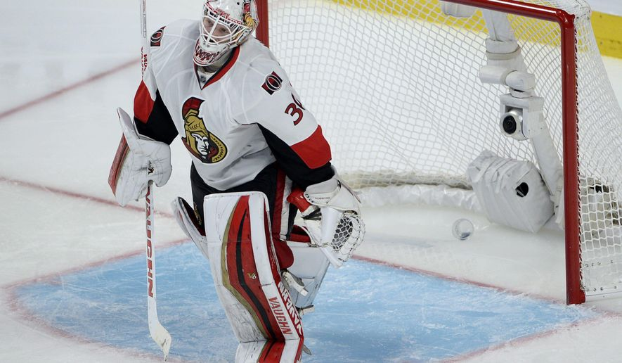 Ottawa Senators goalie Andrew Hammond (30) leaves his crease after letting in the winning goal during the first overtime period in Game 2 of an NHL hockey first-round playoff series, Friday, April 17, 2015 in Montreal. Montreal won 3-2. (Ryan Remiorz/The Canadian Press via AP)  MANDATORY CREDIT