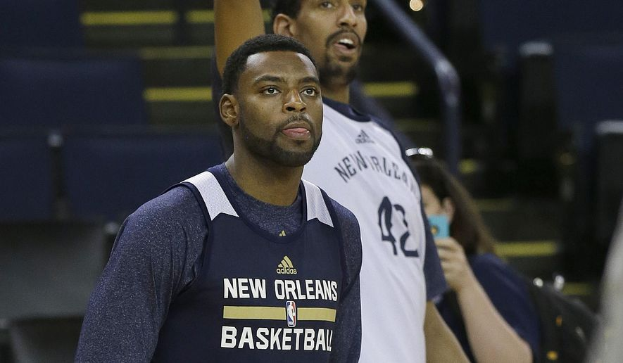 New Orleans Pelicans' Tyreke Evans (1) and Alexis Ajinca shoot during NBA basketball practice in Oakland, Calif., Friday, April 17, 2015. The Pelicans play the Golden State Warriors in Game 1 in the first round of the NBA playoffs on Saturday. (AP Photo/Jeff Chiu)