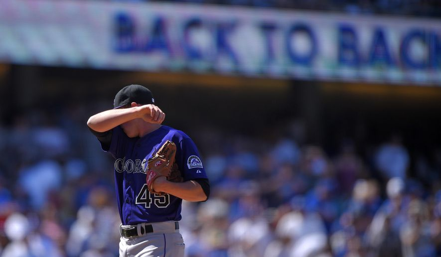 Colorado Rockies relief pitcher Scott Oberg wipes his face after giving up back-to-back home runs to Los Angeles Dodgers' Scott Van Slyke and Joc Pederson during the fifth inning of a baseball game, Sunday, April 19, 2015, in Los Angeles. Dodgers' Howie Kendrick also hit a home run during the inning. (AP Photo/Mark J. Terrill)