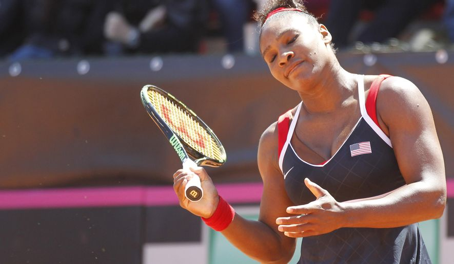 Serena Williams of the United States reacts during a Fed Cup World Group playoff tennis match against Italy's Sara Errani, in Brindisi, Italy, Sunday, April 19, 2015. (AP Photo/Felice Calabro')