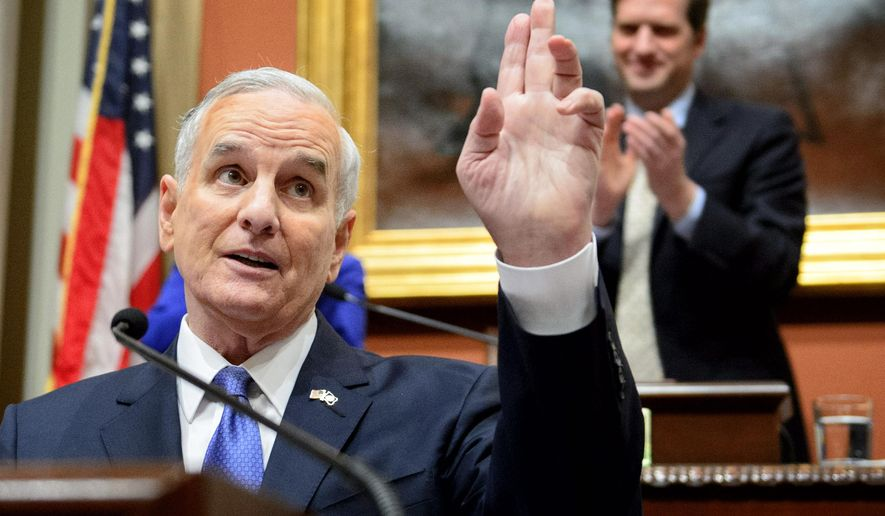 FILE - In this April 9, 2015 file photo, Minnesota Gov. Mark Dayton acknowledges applause at the Minnesota State Capitol in St. Paul, Minn. In their unfolding budget plan, Minnesota legislative Republicans are moving to strip powers from Democratic Gov. Mark Dayton, ranging from limiting his team's authority to write regulatory rules to curbs on the administration's staffing. (AP Photo/The Star Tribune, Glen Stubbe, File)