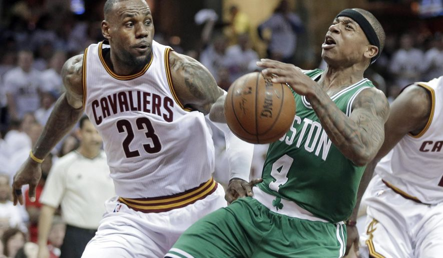 Boston Celtics' Isaiah Thomas (4) loses the ball after a foul by Cleveland Cavaliers' LeBron James (23) in the second quarter of a first-round NBA playoff basketball game Sunday, April 19, 2015, in Cleveland. (AP Photo/Mark Duncan)