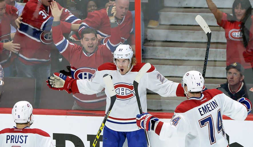 Montreal Canadiens forward Dale Weise (22) celebrates his goal against the Ottawa Senators with teammates Brandon Prust (8) and Alexei Emelin (74) during the third period of game 3 of first round Stanley Cup NHL playoff hockey action in Ottawa, Ontario, Sunday, April 19, 2015. (Sean Kilpatrick/The Canadian Press via AP) MANDATORY CREDIT