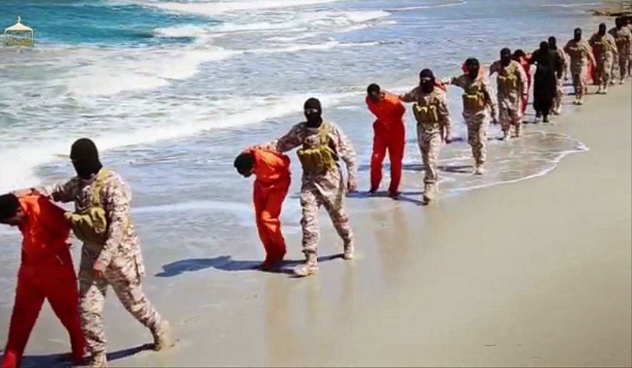 This undated image made from a video released by Islamic State militants, Sunday, April 19, 2015, shows a group of captured Ethiopian Christians taken to a beach before they were killed by Islamic State militants, in Libya. (Associated Press) ** FILE **