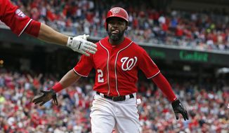 Washington Nationals' Denard Span celebrates after scoring off a double by Ian Desmond during the fifth inning of a baseball game against the Philadelphia Phillies at Nationals Park, Sunday, April 19, 2015, in Washington. (AP Photo/Alex Brandon)