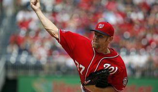 Washington Nationals starting pitcher Stephen Strasburg throws during the  first inning of a baseball game against the Philadelphia Phillies at Nationals Park, Sunday, April 19, 2015, in Washington. (AP Photo/Alex Brandon)