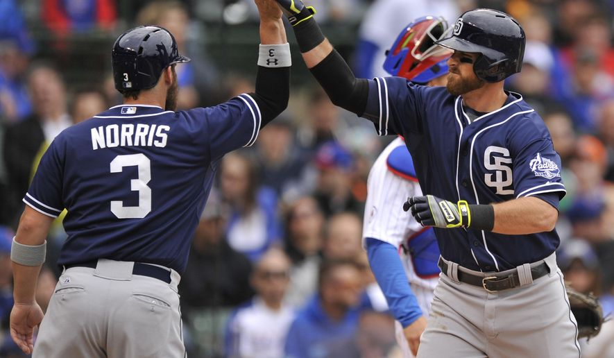 San Diego Padres' Will Middlebrooks, right, celebrates with teammate Derek Norris (3) after hitting a two-run home run during the second inning of a baseball game against the Chicago Cubs, Sunday, April 19, 2015, in Chicago. (AP Photo/Paul Beaty)