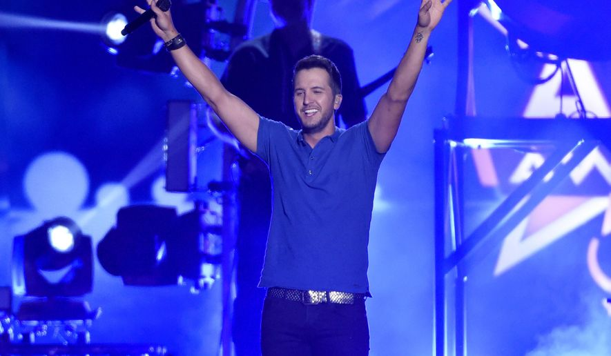 Luke Bryan performs at the 50th annual Academy of Country Music Awards at AT&T Stadium on Sunday, April 19, 2015, in Arlington, Texas. (Photo by Chris Pizzello/Invision/AP)