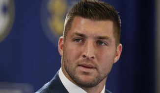 FILE - In this Dec. 5, 2014, file photo, Tim Tebow speaks during an SEC television broadcast in Atlanta. Tebow is expected to sign a one-year contract with the Philadelphia Eagles on Monday, April 20, 2015 according to three people familiar with the deal. (AP Photo/Brynn Anderson, File)