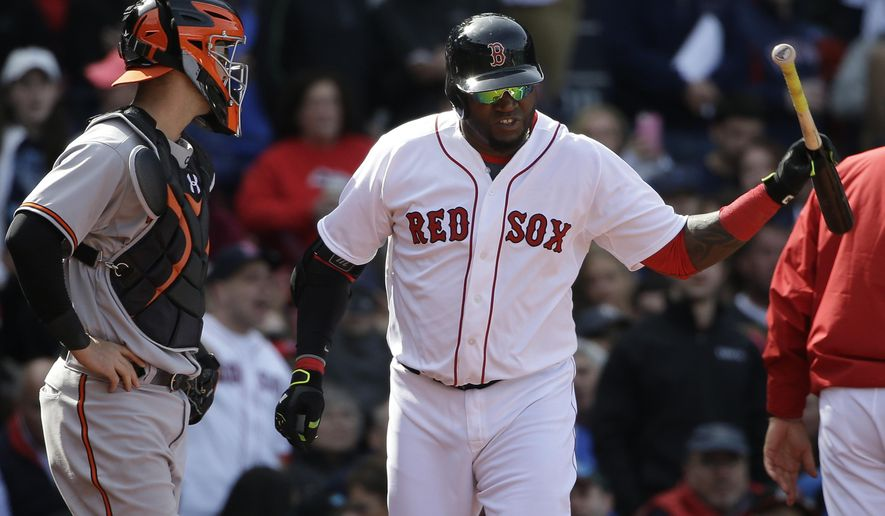 Boston Red Sox's David Ortiz, right, throws his bat after being ejected from a baseball game as Baltimore Orioles' Caleb Joseph, left, looks on during the fifth inning Sunday, April 19, 2015, in Boston. (AP Photo/Steven Senne)