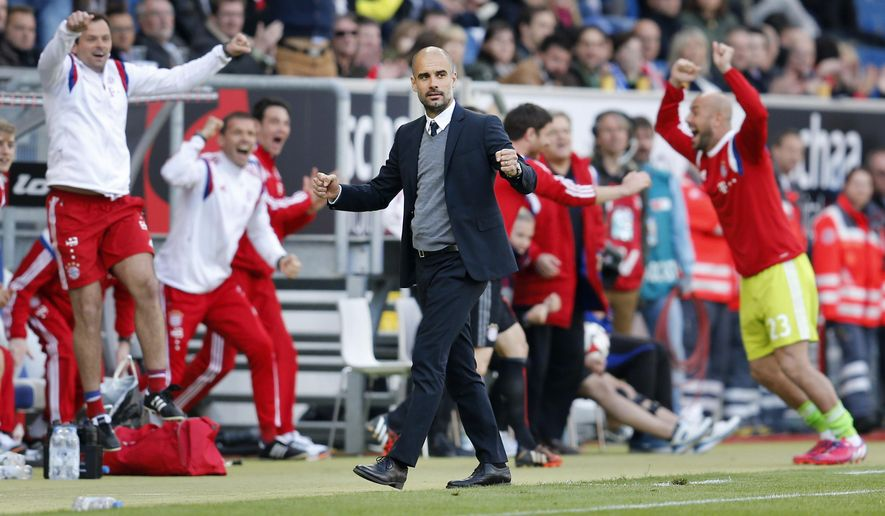 Bayern's head coach Pep Guardiola reacts after his side scored the second goal during a German first division Bundesliga soccer match between TSG 1899 Hoffenheim and Bayern Munich in Sinsheim, Germany, Saturday, April 18, 2015. (AP Photo/Michael Probst)