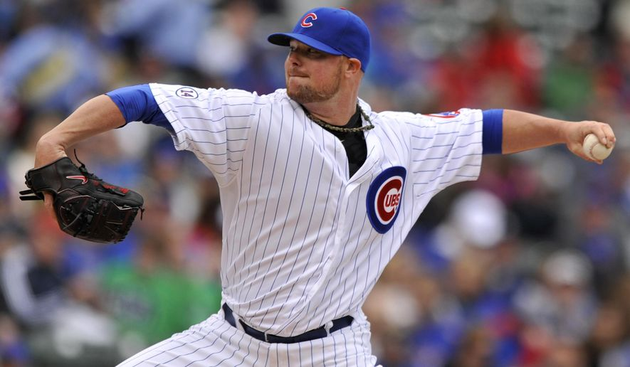 Chicago Cubs starter Jon Lester delivers a pitch during the first inning of a baseball game against the San Diego Padres, Sunday, April 19, 2015, in Chicago. (AP Photo/Paul Beaty)
