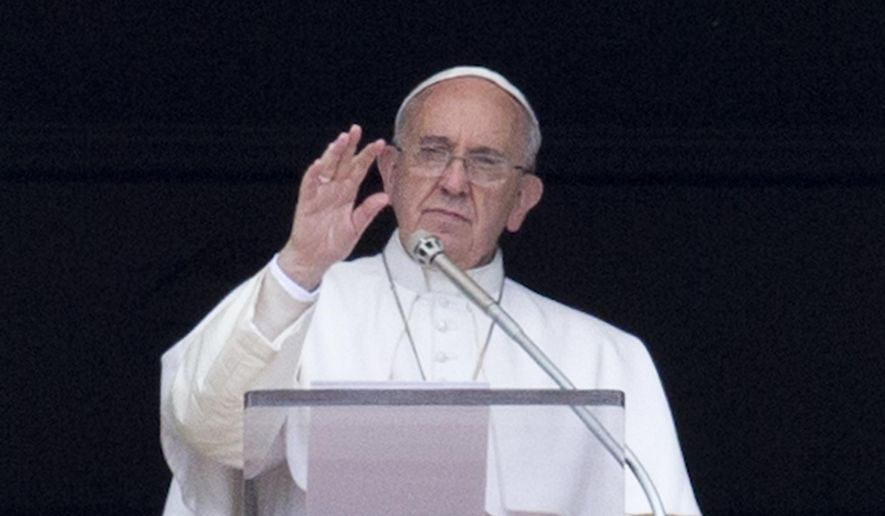 "Pope Francis waves to faithful from the window of his studio overlooking St. Peter's square during the Regina Coeli midday prayer, at the Vatican, Sunday, April 19, 2015. Referring to a boat crowded with migrants capsized in the sea north of Libya, Francis said:""There are fears there could be hundreds of dead"", then he bowed his head in silent prayer as did many of the tens of thousands in the crowd. (AP Photo/Andrew Medichini)"
