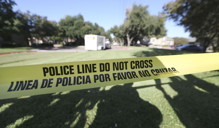 FILE - In this Oct. 15, 2014 file photo, police tape marks where the media is set up, in Dallas. Amid the national focus on deadly police shootings, records show scores of Dallas officers remain on the job despite being punished for serious offenses such as theft, excessive force and lying. (AP Photo/LM Otero, File)