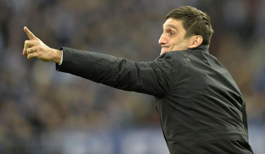 FILE - In this Feb. 9, 2014 file photo Hannover head coach Tayfun Korkut advises his team at the line during the German Bundesliga soccer match between FC Schalke 04 and SV Hannover 96 in Gelsenkirchen,  Germany. The club said Monday, April 20, 2015 that they sacked Korkut.  (AP Photo/Martin Meissner, file)