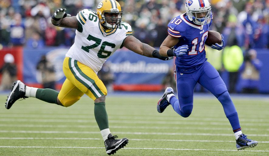 FILE - In this Dec. 2014, file photo, Green Bay Packers defensive end Mike Daniels (76) chases Buffalo Bills' Robert Woods (10) out of bounds during the first half of an NFL football game in Orchard Park, N.Y. The Packers opened offseason workouts, moving on from their crushing loss to Seattle in the NFC title game to start looking ahead to 2015. (AP Photo/Bill Wippert, File)