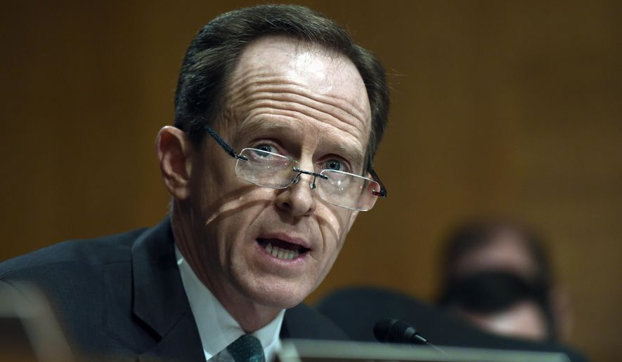 FILE - In this Jan. 27, 2015, file photo, Senate Banking Committee member Sen. Pat Toomey, R-Pa. speaks on Capitol Hill in Washington. Cuts to Medicare and the health care law and almost $40 billion in unrequested money for overseas war-fighting operations top the agenda as congressional negotiators meet Monday to begin ironing out a Republican budget blueprint for next year and beyond. (AP Photo/Susan Walsh)
