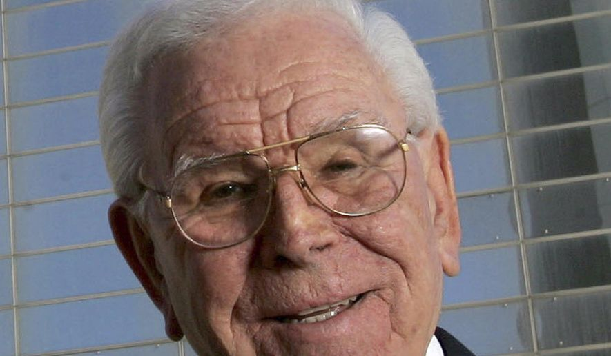 """FILE - In this Feb. 9, 2006, file photo, Robert H. Schuller poses outside the Crystal Cathedral in Garden Grove, Calif. Schuller, the Southern California televangelist who brought his message of """"possibility thinking"""" to millions, died at age 88 on April 2, 2015. A public memorial will be held outside the glimmering cathedral he built in Southern California on Monday, April 20, 2015. The memorial service is open to the public. The church's campus has been bought by the Roman Catholic Diocese of Orange.(AP Photo/Chris Carlson, File)"""