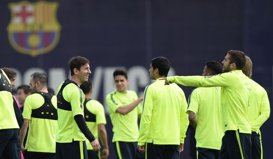 FC Barcelona's Lionel Messi, from Argentina, second left, and Jordi Alba, right, attend a training session with their teammates at the Sports Center FC Barcelona Joan Gamper in San Joan Despi, Spain, Monday, April 20, 2015.  FC Barcelona will play against Paris Saint Germain in a quarterfinal Champions League second leg soccer match on Tuesday April 21. (AP Photo/Manu Fernandez)