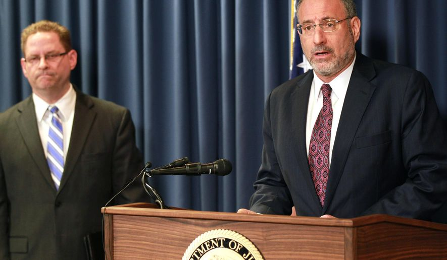 United States Attorney Andrew Luger, right, and FBI special agent Richard Thornton explain the criminal complaint charging six Minnesota men with terrorism at a news conference in Minneapolis, Monday April 20, 2015. The six, whom authorities described as friends who met secretly to plan their travels, are accused of conspiracy to provide material support and attempting to provide material support to a foreign terrorist organization. The complaint says the men planned to reach Syria by flying to nearby countries from Minneapolis, San Diego or New York City, and lied to federal investigators when they were stopped. (AP Photo/Andy Clayton-King)