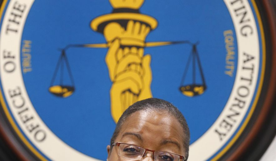 Wayne County Prosecutor Kym Worthy speaks during a news conference in Detroit Monday, April 20, 2015. Worthy has filed charges against a police officer in the bloody arrest of a man who was pulled from his car during a Detroit-area traffic stop. Recently fired Inkster, Mich., officer William Melendez is charged with mistreatment of a prisoner and assault. Floyd Dent was bloody from repeated punches to the head in January. Worthy says there will be no charges in a separate January incident involving officers from Grosse Pointe Park and Highland Park. A carjacking suspect, Andrew Jackson, was on the ground when he was kicked and punched during his arrest in Detroit. (AP Photo/Paul Sancya)