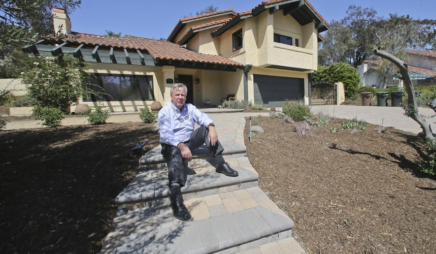 In this April 17, 2015 photo, Jim Reardon, who is awaiting a ruling from a California appeals court regarding his suit over tiered water rates, stands outside his home where he installed drought-tolerant landscaping in San Juan Capistrano, Calif. The appeals court has ruled that the city's tiered water-rates are unconstitutional on Monday, April 20. (AP Photo/Lenny Ignelzi)