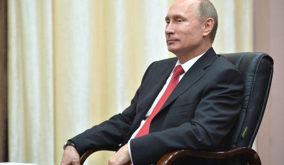 Russian President Vladimir Putin meets with FIFA President Sepp Blatter in the Russian Black Sea resort of Sochi, Russia, Monday, April 20, 2015. (Alexei Druzhinin/RIA Novosti, Kremlin Pool Photo via AP)