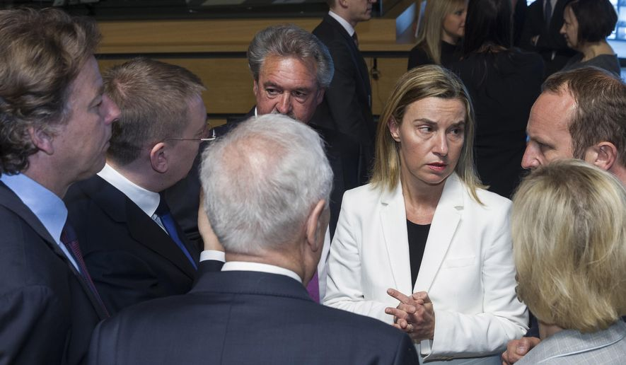 European Union High Representative Federica Mogherini, third right, speaks with EU foreign ministers during a meeting at the EU Council building in Luxembourg on Monday, April 20, 2015. An Italian coast guard ship headed toward Sicily Monday to look for survivors of a capsized ship in what could be the Mediterranean's deadliest migrant tragedy, as EU foreign ministers gathered for an emergency meeting to discuss the crisis. Front row ministers from left, Dutch Foreign Minister Bert Koenders, Spanish Foreign Minister Jose Manuel Garcia-Margallo, Swedish Foreign Minister Margot Wallstrom and Danish Foreign Minister Martin Lidegaard. (AP Photo/Thierry Monasse)
