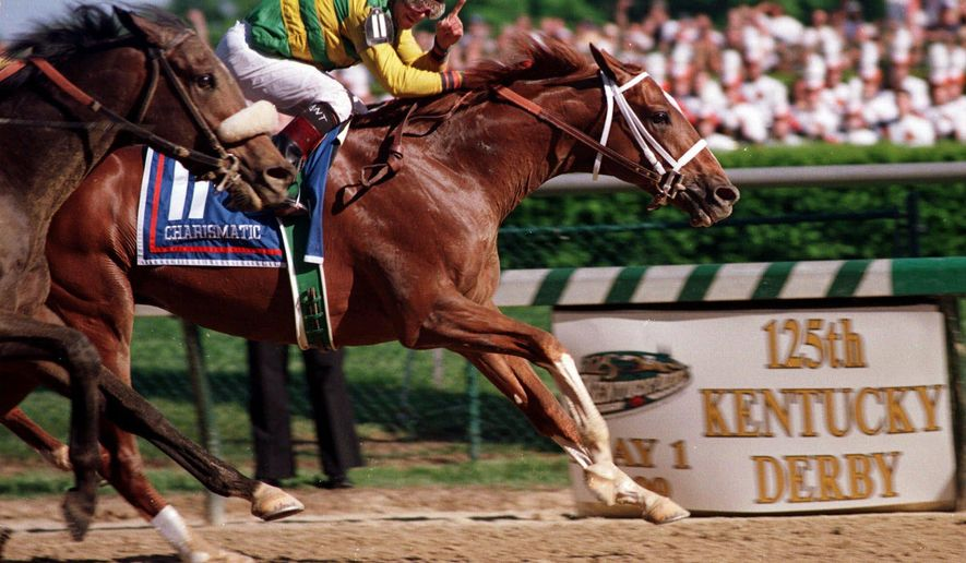 FILE - In this May, 1999, file photo, jockey Chris Antley, aboard Charismatic, signals his win as he crosses the finish line to capture the 125th running of the Kentucky Derby in Louisville, Ky. Antley, the late jockey who twice won the Kentucky Derby, was elected to the National Museum of Racing's Hall of Fame on Monday with thoroughbreds Lava Man and Xtra Heat and trainer King Leatherbury. (AP Photo/Patti Longmire, File)