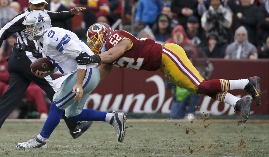 "In this photo taken Dec. 28, 2014, Dallas Cowboys quarterback Tony Romo (9) is sacked by Washington Redskins inside linebacker Keenan Robinson (52) during the first half of an NFL football game in Landover, Md. Robinson came away expecting good things after his first chance to hear new Washington Redskins defensive coordinator Joe Barry speak at a team meeting. ""I took away just a defense that's going to be fast and physical, more so than we were last year. And just have a different approach to it. We're still going to stress everyone flying around, finishing plays, stripping, tackling, all that,"" Robinson told reporters on a conference call Monday, the start of offseason workouts in Ashburn, Virginia.  (AP Photo/Alex Brandon)"