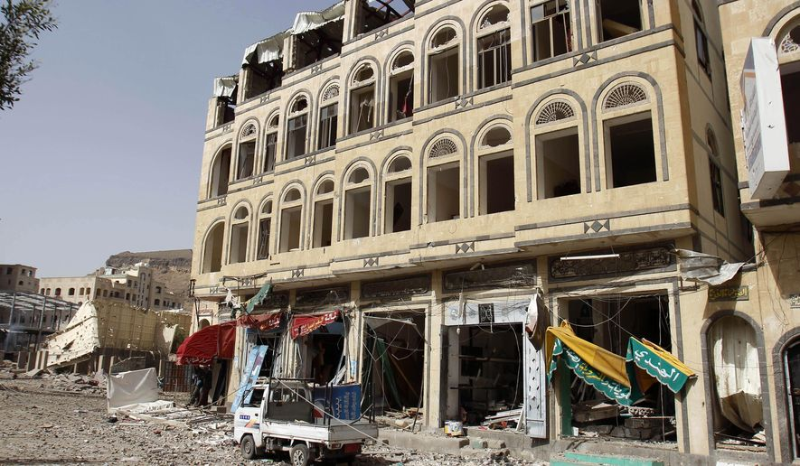 A street is littered with debris after a Saudi-led airstrike against Iran-allied Shiite rebels, known as Houthis, hit a site of a weapons cache in Yemen's capital, Monday, April 20, 2015. Airstrikes on weapons caches in Yemen's rebel-held capital on Monday caused massive explosions that shattered windows, sent residents scrambling for shelter and killed a local TV presenter. (AP Photo/Hani Mohammed)