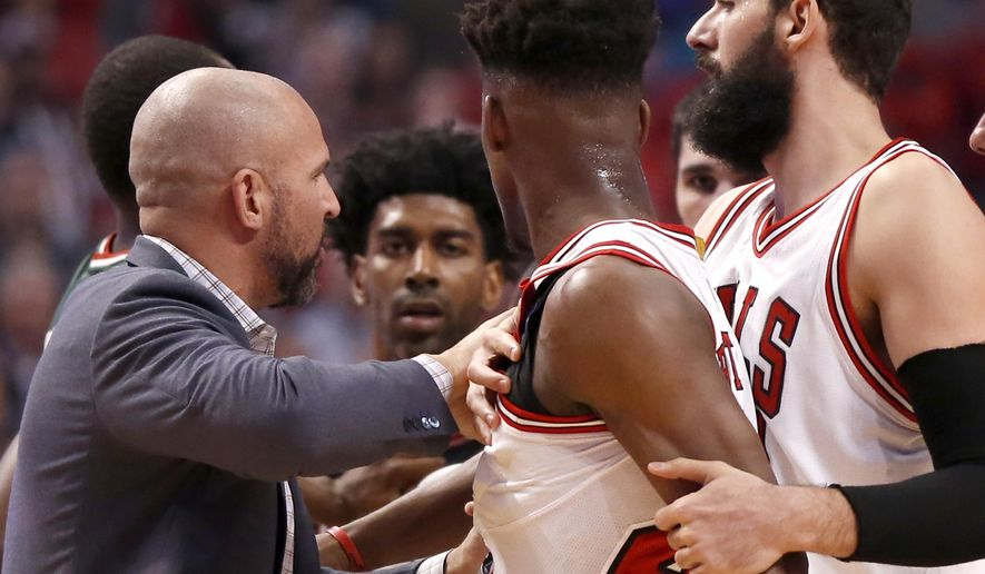Milwaukee Bucks head coach Jason Kidd, left, and Chicago Bulls forward Nikola Mirotic, right, pull Jimmy Butler away from O.J. Mayo, as the two have words during the first half in Game 2 of the NBA basketball playoffs Monday, April 20, 2015, in Chicago. (AP Photo/Charles Rex Arbogast)