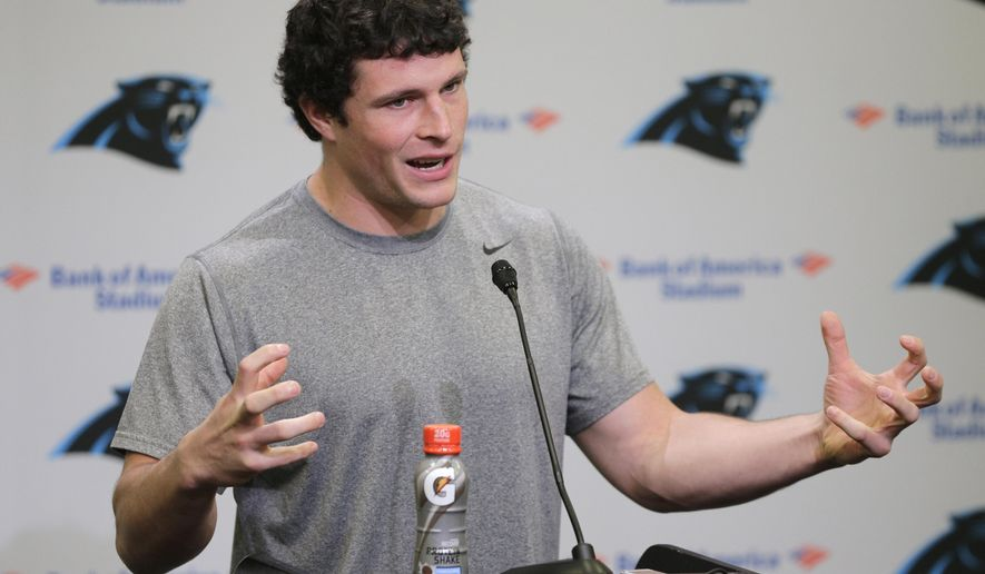Carolina Panthers' Luke Kuechly speaks to the media during the first day of their NFL football offseason conditioning program, Monday, April 20, 2015, in Charlotte, N.C. (AP Photo/Chuck Burton)