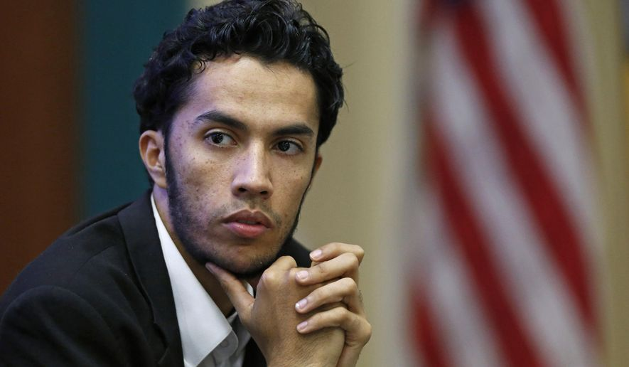 In this March,  27, 2015 photo,Youssef Edghouch listens during a discussion on American Muslims and civic engagement from the local to the national level, at the Islamic Center of San Gabriel Valley in Rowland Heights, Calif. The Obama administration has launched a pilot program in several cities charged with tackling global terrorism on a local scale by preventing radicalization from taking root. If the efforts are successful, they would be rolled out nationwide. (AP Photo/Christine Cotter)