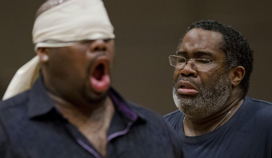 "In this Wednesday, April 8, 2015 photo, Eric Owens, right, and Morris Robinson perform during a rehearsal of the opera ""Don Carlo,"" at the Academy of Music in Philadelphia. Five performances are scheduled to be staged from April 24 to May 3. (AP Photo/Matt Rourke)"