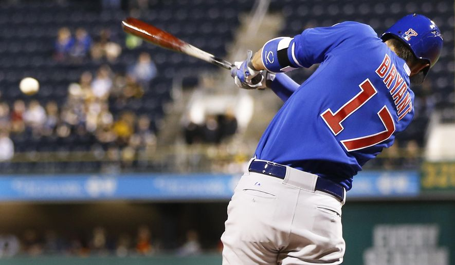 Chicago Cubs' Kris Bryant (17) gets a base hit off Pittsburgh Pirates starting pitcher A.J. Burnett to drive in Jorge Soler in the fifth inning of a baseball game on Monday, April 20, 2015, in Pittsburgh. (AP Photo/Keith Srakocic)