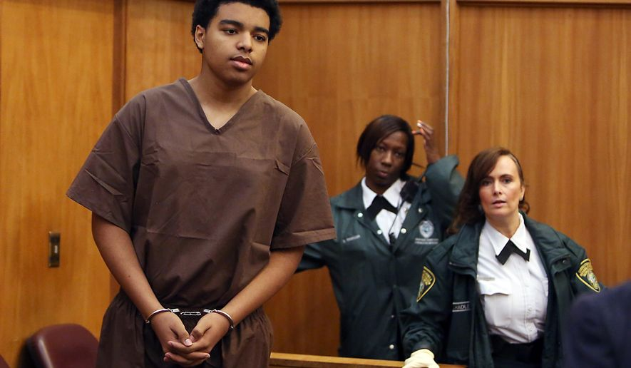 Marc Wabafiyebazu, 15, appears in adult criminal court during his arraignment, Monday, April 20, 2015, in Miami. Wabafiyebazu, son of a Canadian diplomat, has pleaded not guilty to murder charges in a Miami drug-related shootout that killed his older brother. (Walter Michot/The Miami Herald via AP, Pool)