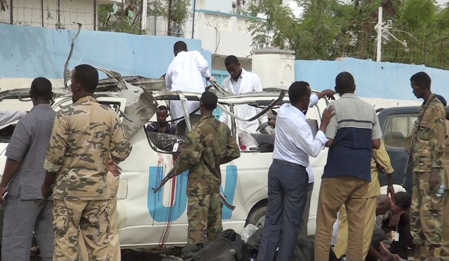 This image made from video shows the scene following a bomb attack on a van carrying U.N. employees in Garowe, in the semiautonomous Puntland region of northern Somalia Monday, April 20, 2015. (AP Photo)