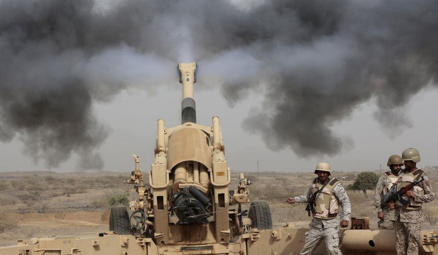 Saudi soldiers fire artillery toward three armed vehicles approaching the Saudi border with Yemen in Jazan, Saudi Arabia, Monday, April 20, 2015. The Saudi air campaign in Yemen is now in its fourth week. (AP Photo/Hasan Jamali)