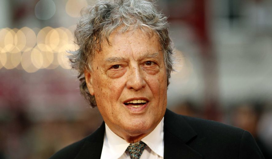 """FILE - In this Sept. 4, 2012 file photo, British playwright Tom Stoppard poses as he arrives for the world premiere of """"Anna Karenina,"""" in London. Stoppard is to accept the PEN/Allen Foundation Literary Service Award, the highest honor bestowed by the American chapter of the global human-rights organization of writers and editors. (AP Photo/Sang Tan, File)"""