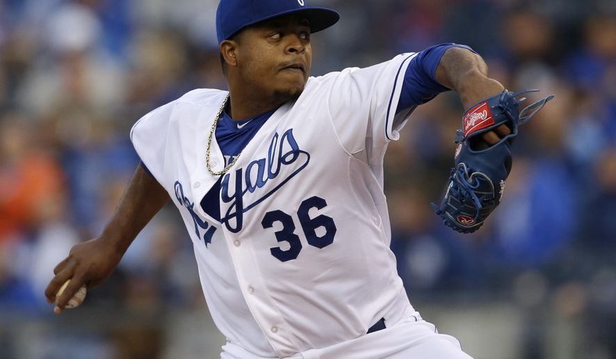 Kansas City Royals starting pitcher Edinson Volquez delivers to a Minnesota Twins batter during the first inning of a baseball game at Kauffman Stadium in Kansas City, Mo., Monday, April 20, 2015. (AP Photo/Orlin Wagner)